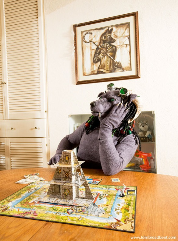 Zuki, a Gargoyle playing a table-top roleplay game.  Zuki lives in Milton Keynes and works in IT. Zuki owns a few suits, the gargoyle is just one of them.