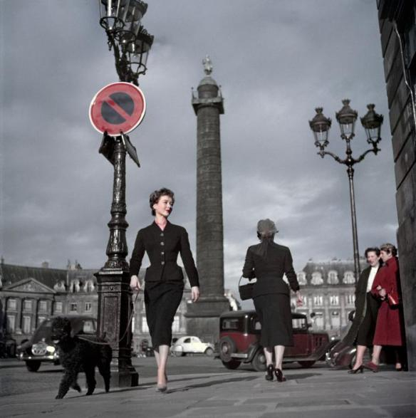 "FRANCE. Paris. Vendome Square (Place Vendôme). A Dior model, wearing a ""New Look"" long skirt. 1948 © Robert Capa/International Center of Photography/Magnum"
