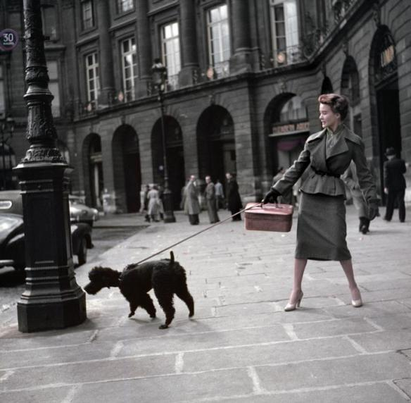 "FRANCE. Paris. Vendome Square (Place Vendôme). A Dior model, wearing a ""New Look"" long skirt. 1948 ©Robert Capa/International Center of Photography/Magnum"