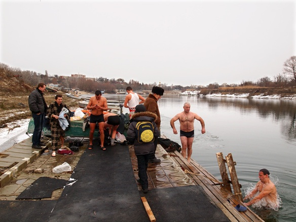 Ten days after Orthodox Christmas, starting at midnight, as many as one thousand Transnistrians, aged from 6 to 60, strip down to their underwear and plunge into the Nistru river at Tiraspol.  'I feel such warmth in my heart,' said Dimitri Sheremet, leader of the Dixieland 'Liberty' band when he emerged from the freezing water. © Nick Danziger / nb* pictures